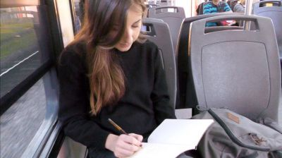 Céline working hard on the train to visit a project