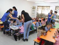Veena volunteering with children